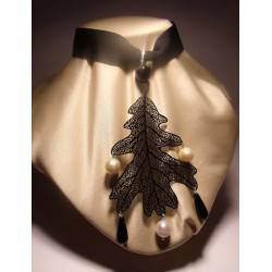 Metal leaf pendant with onyx and pearls