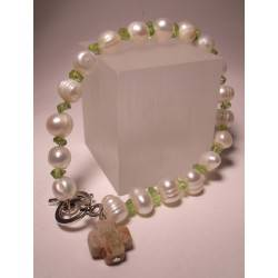 Bracelet with freshwater pearls, peridot and unakite cross