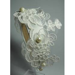 Headband with white embroidery application and pearls